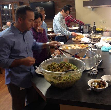 Employees enjoying the food