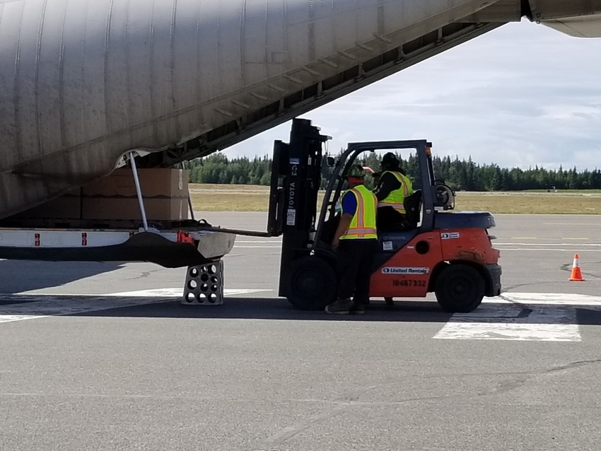 A forklift takes the chartered ...